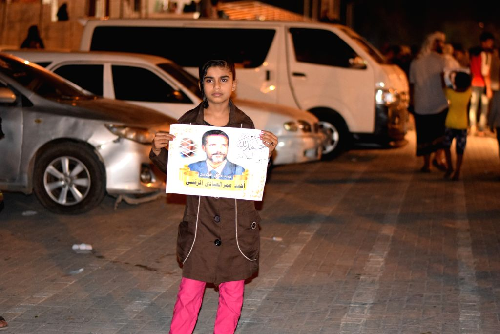 ADEN (YEMEN), May 27, 2019 A supporter holds a picture of pro-secession leader Ahmed Omar Marqashi in Aden, Yemen, on May 27, 2019. Hundreds of Yemenis on Monday gathered in a public ...