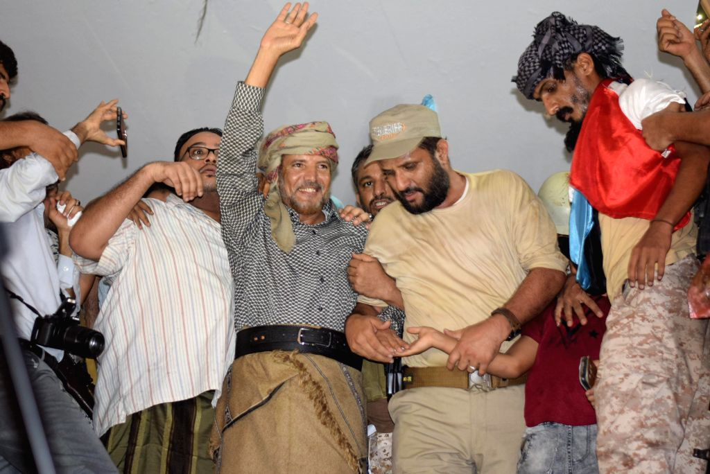 ADEN (YEMEN), May 27, 2019 Released pro-secession leader Ahmed Omar Marqashi (C) waves to supporters in Aden, Yemen, on May 27, 2019. Hundreds of Yemenis on Monday gathered in a public ...