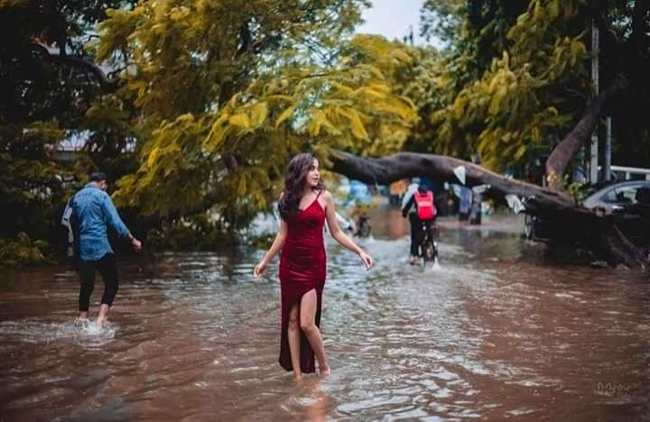 Aditi Singh, a student of the National Institute of Fashion Technology (NIFT), posing on the waterlogged streets of Patna. - Singh