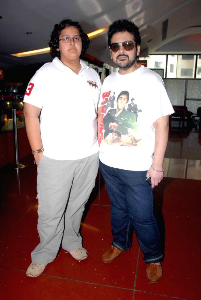 Adnan Sami with his son at Apneeaap NGO special screening at Cinemax. - Adnan Sami