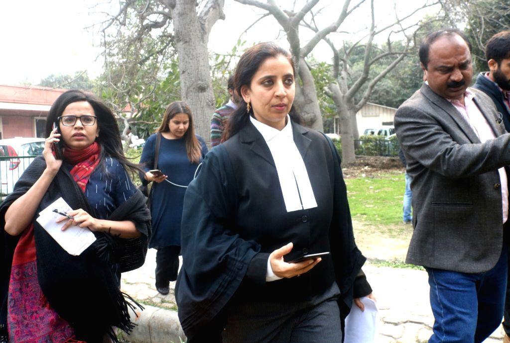 Advocate Aishwarya Bhati, lawyer of Lt Col Karamveer Singh, father of Major Aditya Kumar, named in an FIR by Jammu and Kashmir Police in civilian killings during a firing incident, ... - Karamveer Singh and Aditya Kumar