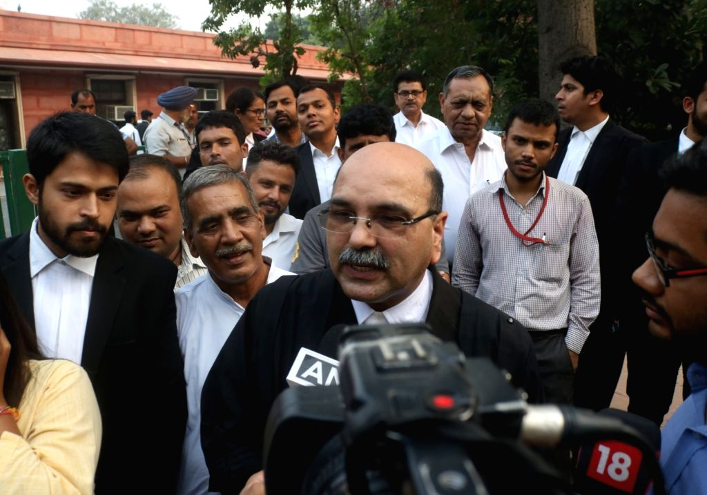 Advocate for Hindu Mahasabha Varun Sinha, talks to the media outside the Supreme Court after the hearing in Ayodhya title dispute case came to an end, in New Delhi on Oct 16, 2019. After ... - Mahasabha Varun Sinha