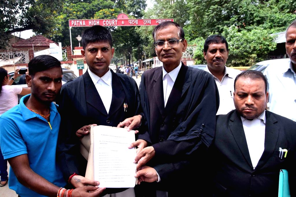 Advocates show papers after filing a plea challenging the Motor Vehicles Act 2019 in Patna High Court, on Sep 13, 2019.