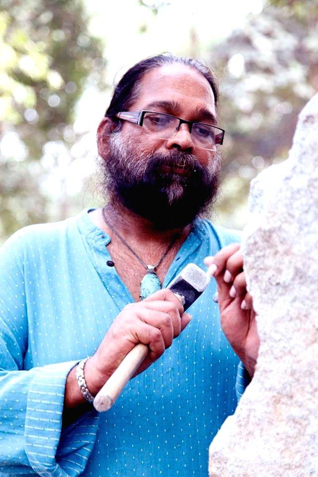 Adwaita Garanayak sculpting the memorial.