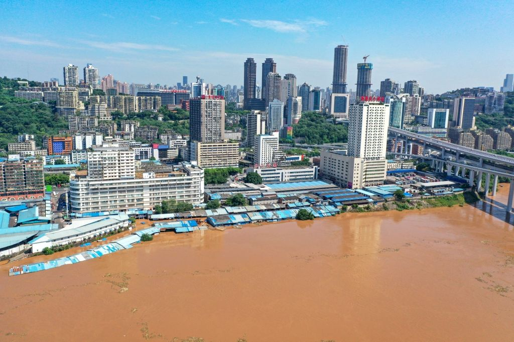Aerial photo taken on Aug. 14, 2020 shows a wholesale market flooded by the Yangtze River at Caiyuanba, southwest China's Chongqing Municipality. Yangtze River, ...