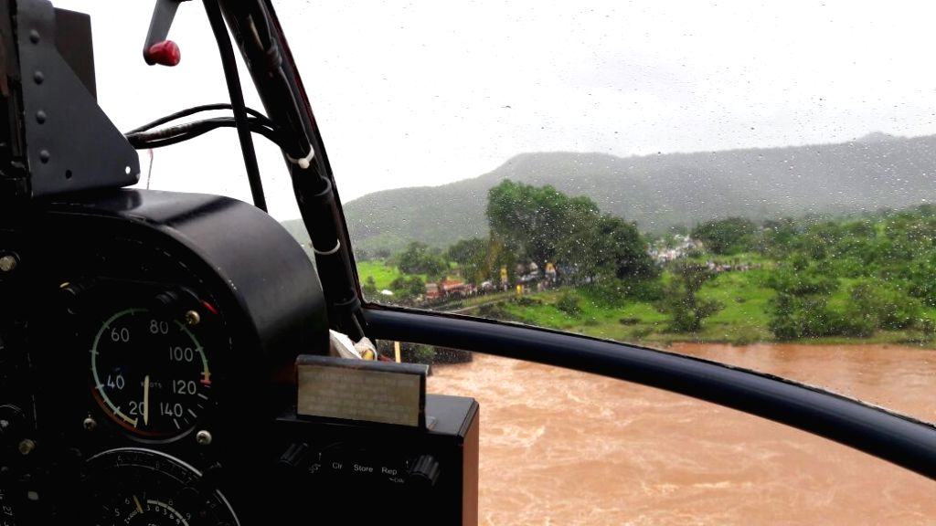 Aerial view of the site where at least two buses with about 22 passengers were washed away in flood waters after a bridge collapse on the Mumbai-Goa Highway in Raigad of Maharashtra on Aug 3, ...