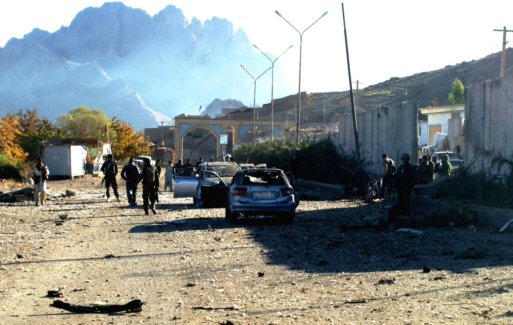 Afghan army soldiers inspect the attack site in Arghandab district of southern Kandahar province, Afghanistan, Nov. 19, 2015. At least five militants and one ...