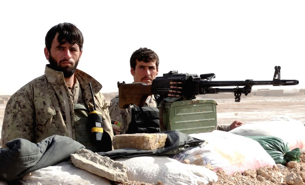 Afghan army soldiers stand at a checkpoint during a military operation in Marjah district of southern Helmand province of Afghanistan, Dec. 6, 2015. Helmand province ...