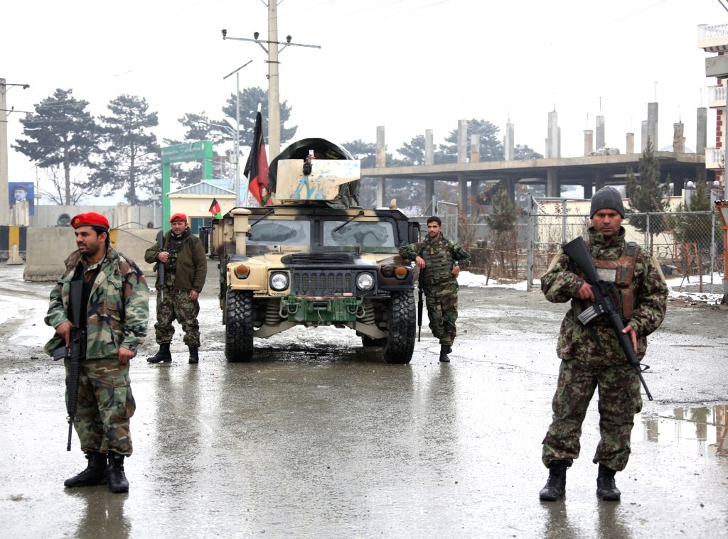 : Afghan army soldiers stand outside Marshal Fahim National Defense University after attack in Kabul, Afghanistan, Jan. 29, 2018. Militants' attack on a Afghan ...