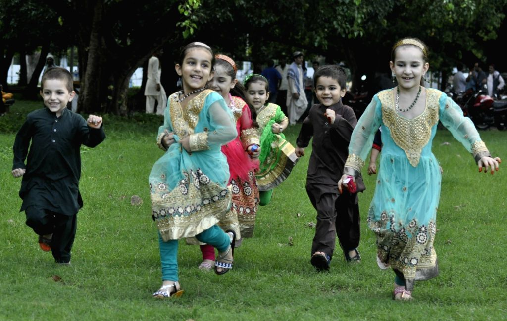 Afghan children enjoy after prayers on the occasion of Eid-ul-Fitr at Maidan in Kolkata on June 26, 2017.