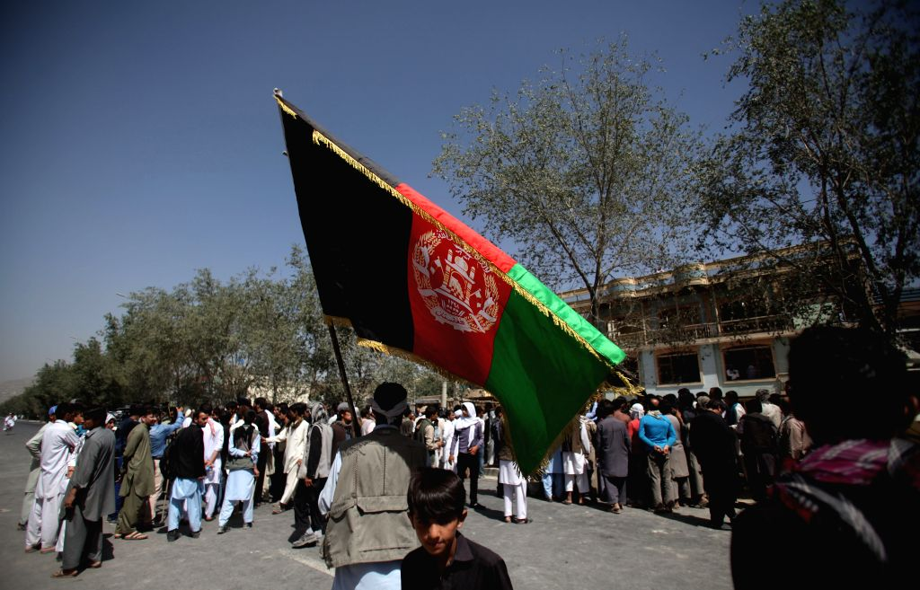 Afghan people attend in a protest against Taliban during a protest in Kabul, Afghanistan, Aug. 10, 2015. Hundreds of Kabul residents took to streets on Monday, ...