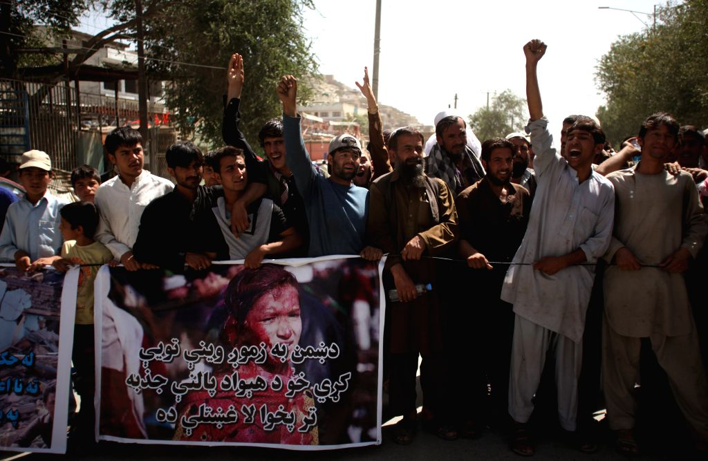Afghan people shout slogans against Taliban during a protest in Kabul, Afghanistan, Aug. 10, 2015. Hundreds of Kabul residents took to streets on Monday, calling on ...