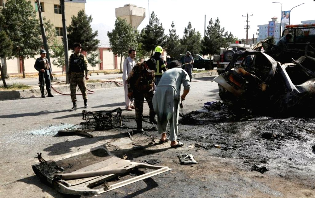 Afghan security force members inspect the site of an explosion in Kabul, capital of Afghanistan, June 12, 2021.