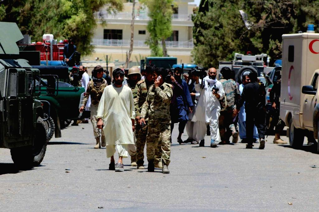 Afghan security force members inspect the site of an attack in Helmand province, Afghanistan, June 22, 2017. At least 26 Afghans were killed and 59 others wounded when an explosion rocked a ...
