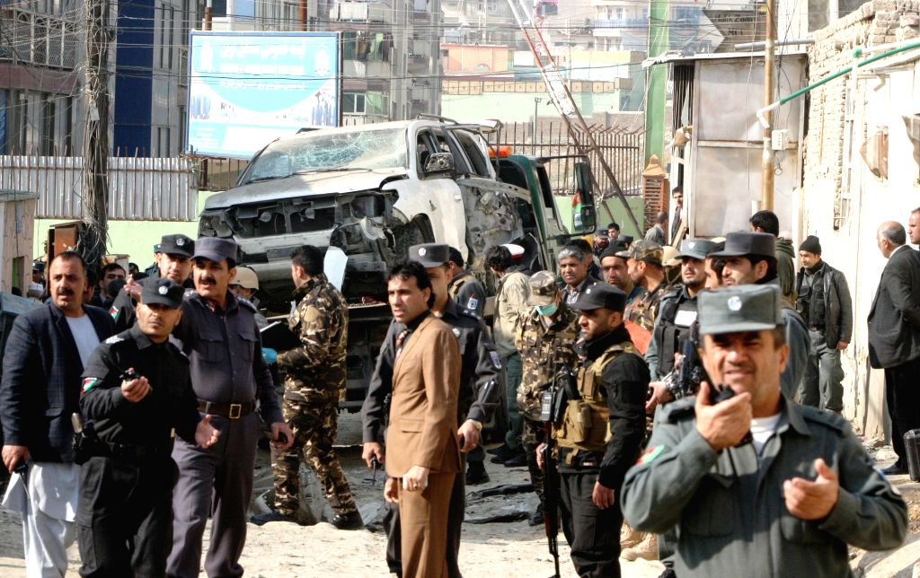 Afghan security forces inspect the site of a suicide attack in Kabul, capital of Afghanistan, Nov. 28, 2015. Two persons including the attacker were killed and two ...