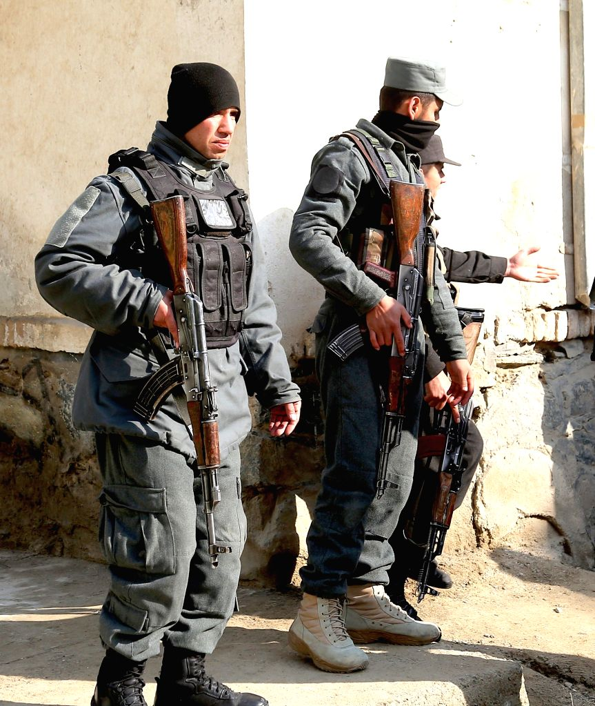 Afghan security forces stand guard at the site of a suicide attack in Kabul, capital of Afghanistan, Nov. 28, 2015. Two persons including the attacker were killed and ...