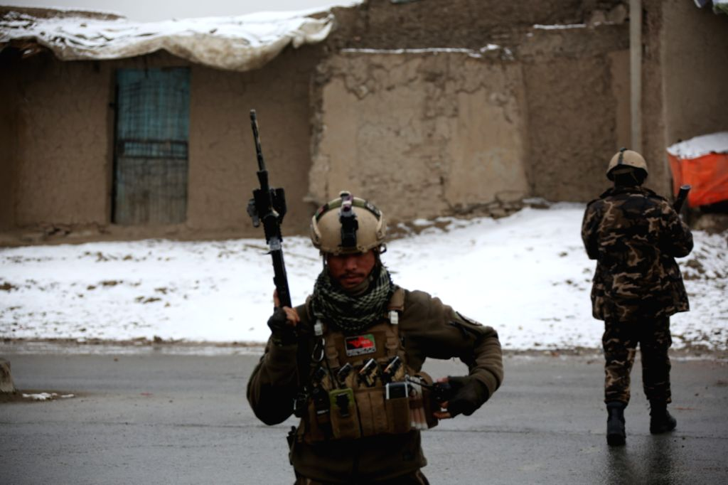 : Afghan security personnel cordon off the site of the attack on a military university in Kabul, capital of Afghanistan, on Jan. 29, 2018. Gunmen attacked a military ...