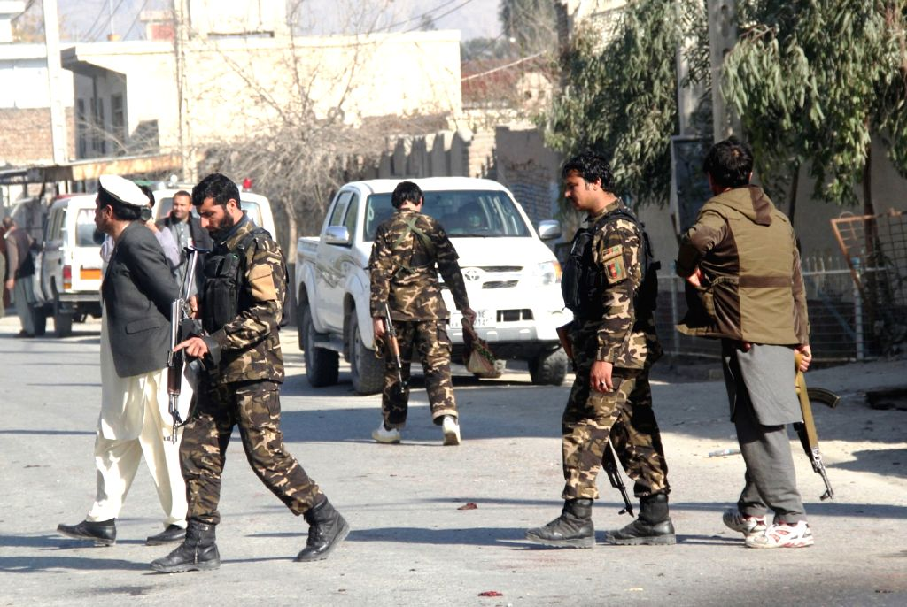 Afghan security personnel inspect the blast site in Nangarhar province, Afghanistan, Jan. 17, 2016. About 12 people were killed and 13 others wounded after a ...