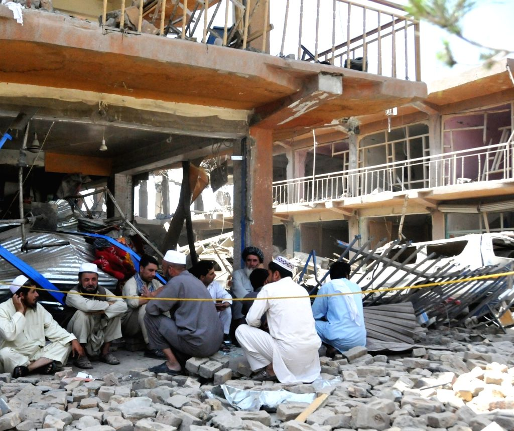 Afghan shop owners sit in front of their destroyed shops at the blast site in Kabul, Afghanistan, Aug. 7, 2015. At least 8 civilians were killed and nearly 400 other ...