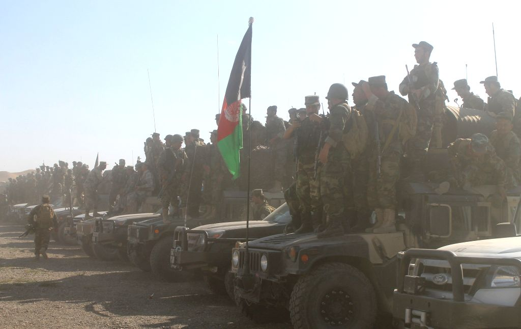 Afghan soldiers gather around their vehicles at a military camp in Faryab Province, north Afghanistan, Aug. 5, 2015. Units of Afghan national police backed by the ...