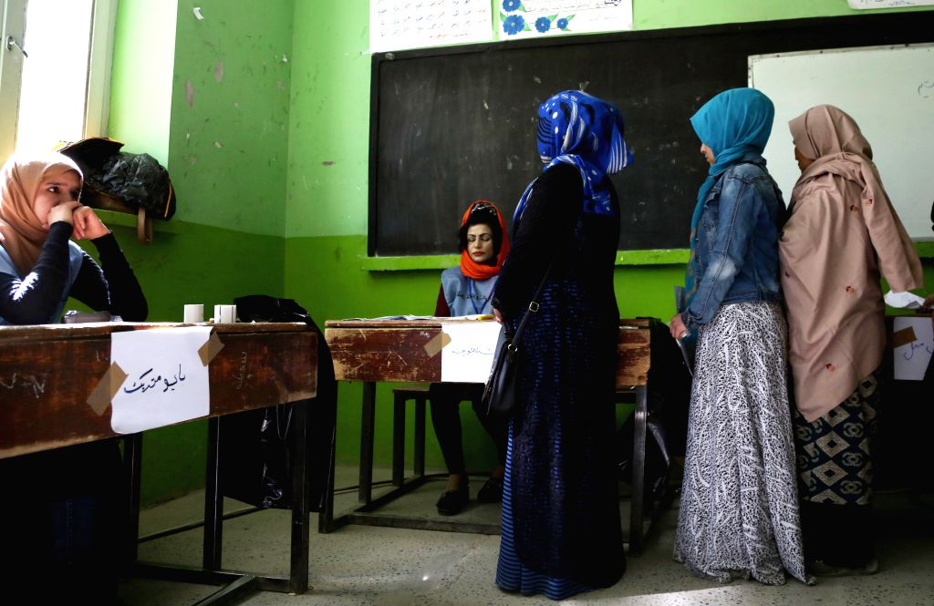 :Afghan voters wait to cast their ballots at a polling center during parliamentary elections in Kabul, Afghanistan, Oct. 20, 2018. Millions of Afghan voters cast ...