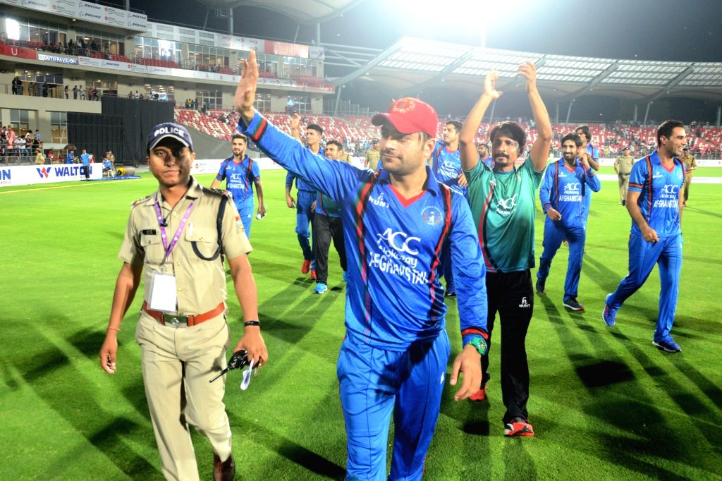 Afghanistan bowler Rashid Khan who got man of the series waving to his fans after winning T20 cricket match series between Bangladesh and Afghanistan in Dehradun on June 7, 2018. - Rashid Khan