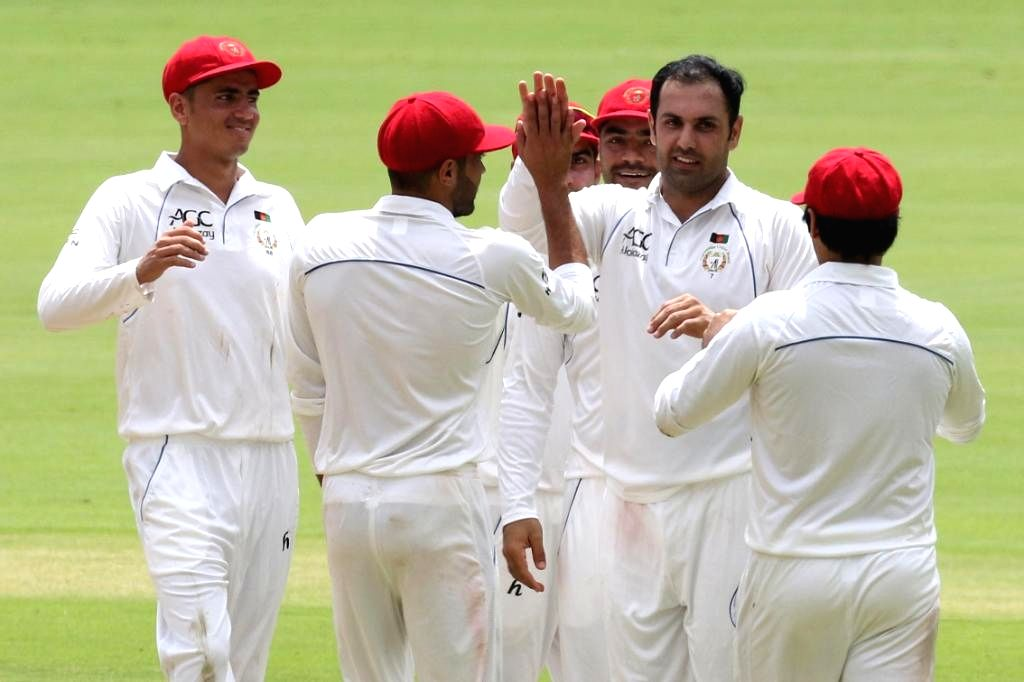 Afghanistan's Mohammad Nabi celebrates fall of a wicket on Day 2 of the Only Test between Afghanistan and Bangladesh at Zahur Ahmed Chowdhury Stadium in Chittagong, Bangladesh on Sep 6, ...