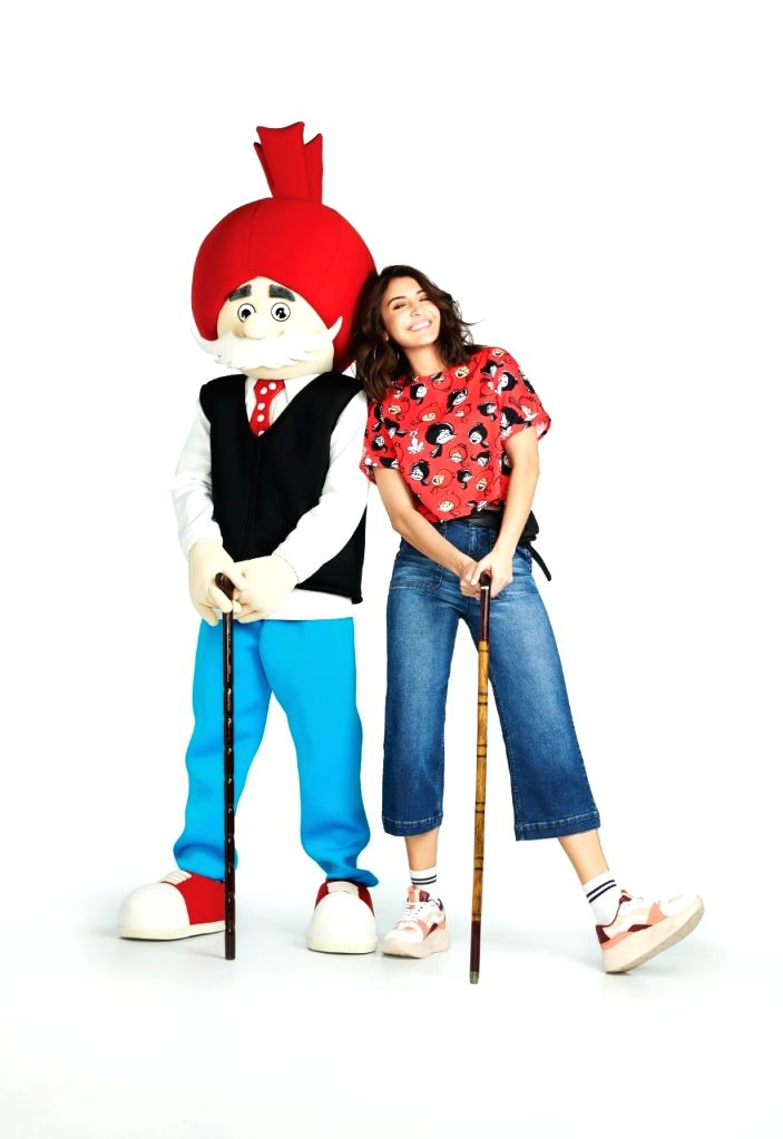After drawing inspiration from the popular character from the Tinkle comics' Suppandi, actress Anushka Sharma new muse is another famous Indian comic character Chacha Chaudhary for the new collection ... - Anushka Sharma and Chacha Chaudhary