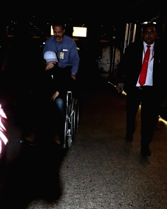 """After shooting for his film """"Angrezi Medium"""" in London, actor Irrfan Khan has returned to India. Irrfan was spotted at Mumbai airport on Friday. A lot of pictures are doing the rounds on the Internet in which he is seen hiding his face and using whee - Irrfan Khan"""