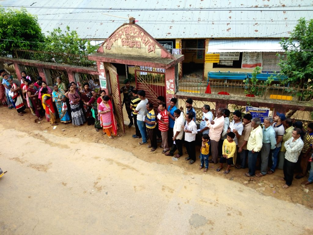 Agartala: People queue up early morning to cast their vote at a polling centre in Agartala April 11,  2019. (Photo: IANS)