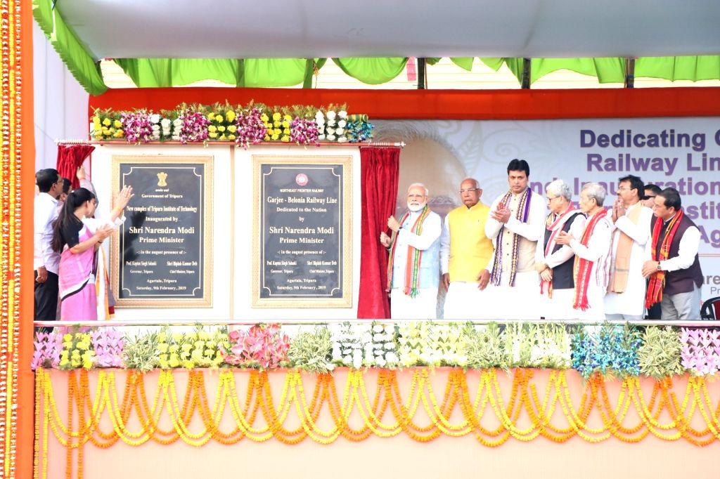 Agartala: Prime Minister Narendra Modi unveils the plague to inaugurate Garjee-Belonia railway line in Agartala, on Feb 9, 2019. Also seen Tripura Governor Kaptan Singh Solanki and Chief Minister Biplab Kumar Deb. (Photo: IANS) - Narendra Modi, Kaptan Singh Solanki and Biplab Kumar Deb
