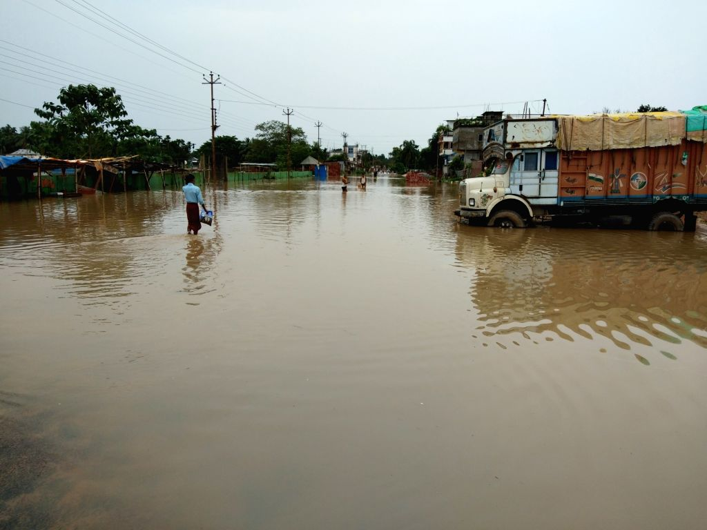 Agartala: The outskirts of Agartala submerged in flood water, on July 15, 2019. According to officials, over 12,000 people have taken shelter in 38 relief camps on the outskirts of Agartala, and Jirania, Kalyanpur and Teliamura in western Tripura. Ag