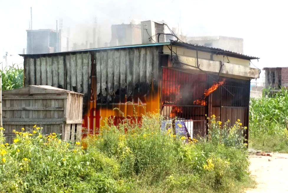 Agitating crowd set on fire a liquor shop near the Ryan International School over death of 7-year-old Pradyuman in Gurugram on Sept 10, 2017.