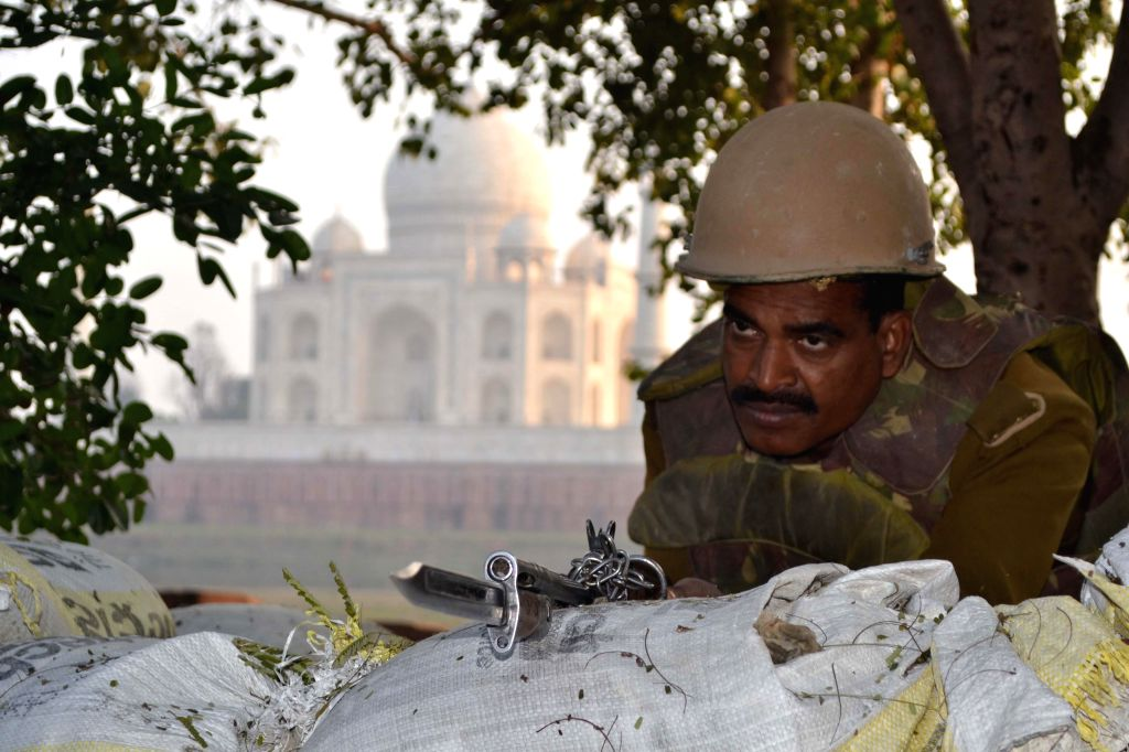 A security personnel on guard in front of Taj Mahal in Agra on Jan. 24, 2015.