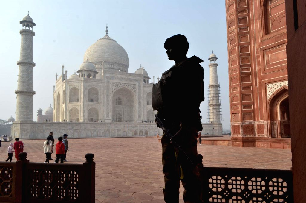 A soldier stands guard at the Taj Mahal ahead of US President Barack Obama's expected visit on 27th January 2015, in Agra, on Jan 20, 2015.