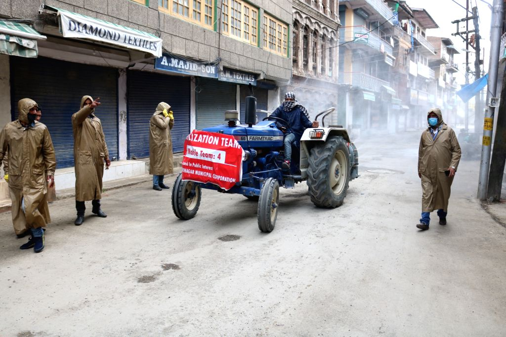 Agra, April 11 (IANS) Agra city MP SP Singh Baghael, on Saturday led a fleet of 50 tractors with tanks to spray sodium hydrochloride to sanitise the hotspots in the city. (File Photo: IANS)