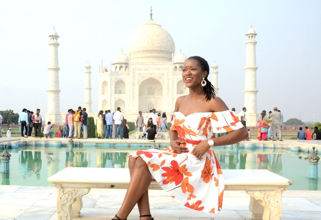:Agra: Miss Universe Great Britain 2018 Dee-Ann Rogers visits the Taj Mahal in Agra, Uttar Pradesh on Oct 30, 2018. (Photo: IANS).