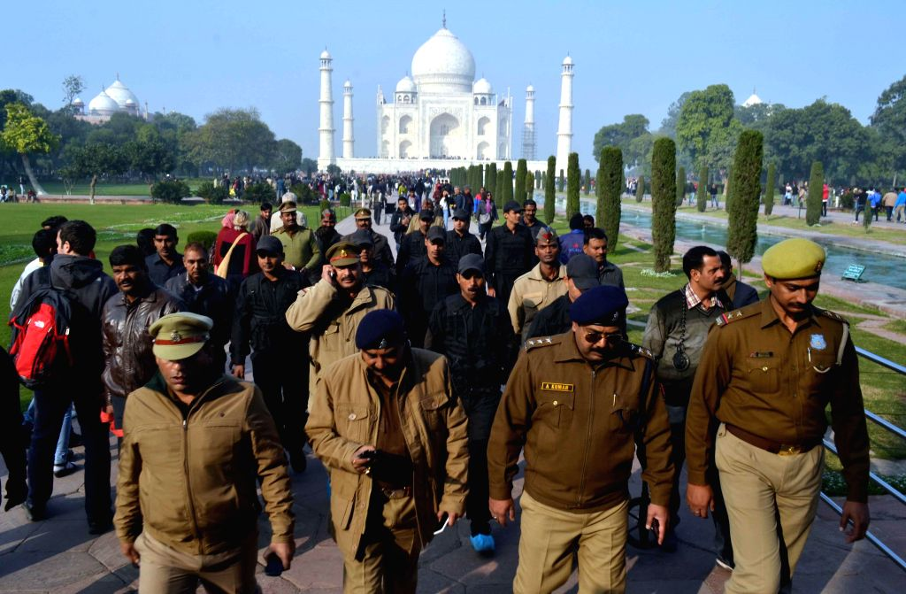 Police officials inspect security measures at the Taj Mahal ahead of US President Barack Obama's visit, in Agra on Dec 22, 2014.