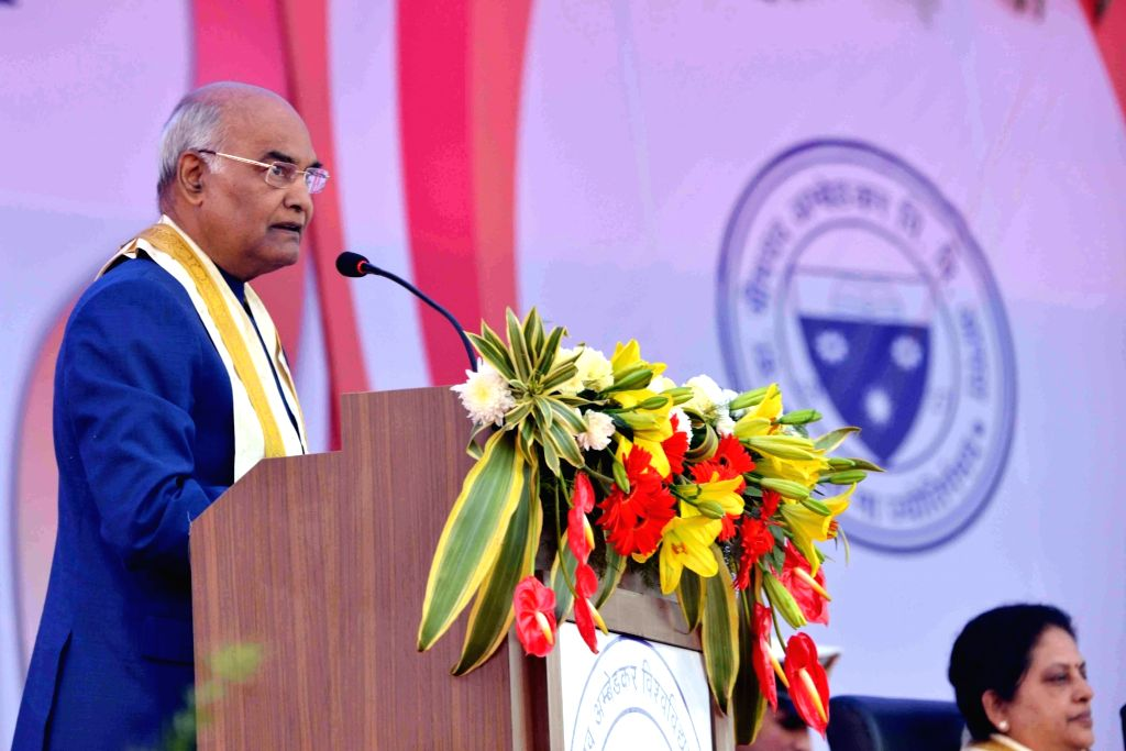 :Agra: President Ram Nath Kovind addresses during the 83rd Convocation of Dr. Bhimrao Ambedkar University in Agra on Dec 5, 2017. (Photo: IANS/RB).