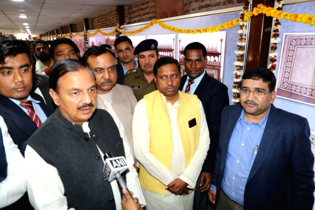 Agra: Union MoS Culture (I/C) and Environment, Forest and Climate Change, Dr. Mahesh Sharma during the inauguration of a permanent photo exhibition near the newly constructed visitor's facility centre at the eastern gate of Taj Mahal, at the Foundati - Mahesh Sharma