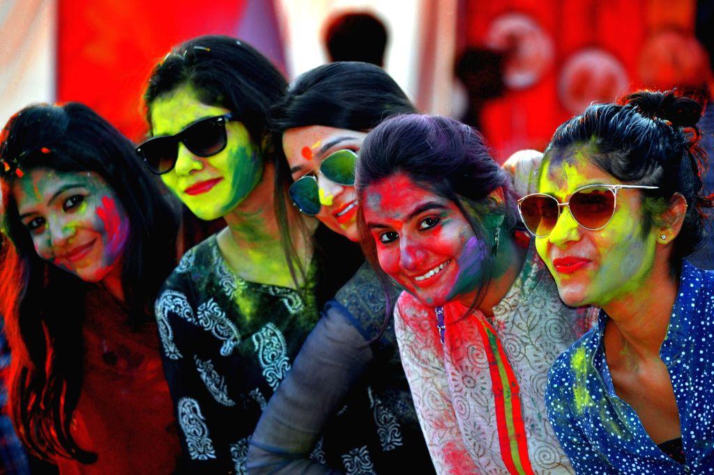 Women celebrate holi in Agra, on March 5, 2015.