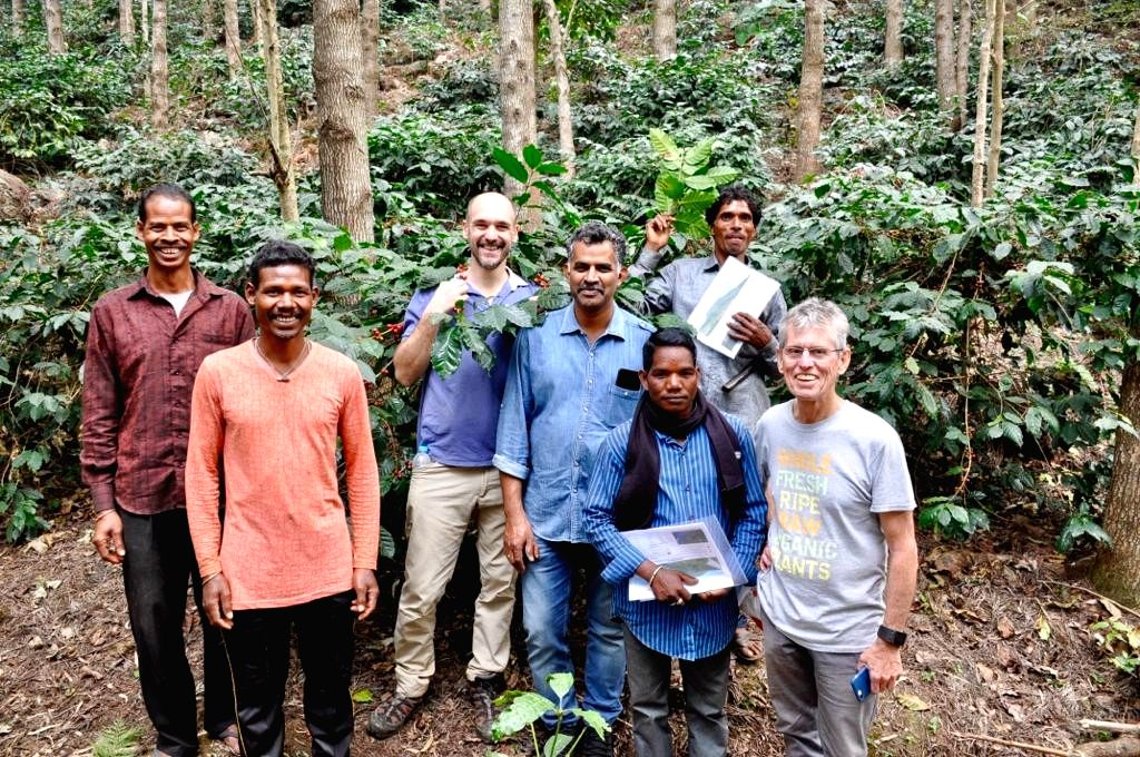 Agriculture Scientist & Araku Biodynamics Expert, David Hogg and Araku Coffeologist Hippolyte Courty with the farmers in Coffee plantations.