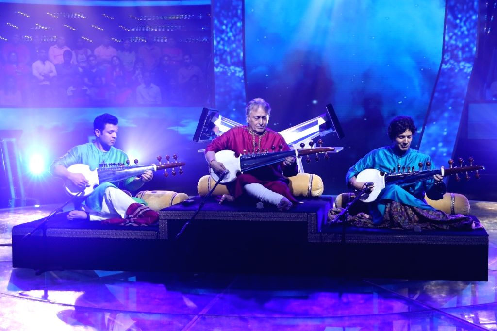"Ahead of megastar Amitabh Bachchan's 77th birthday on Friday, legendary sarod player Ustad Amjad Ali Khan, along with sons Amaan and Ayaan, has prepared a musical tribute on ""Kaun Banega ... - Amitabh Bachchan"