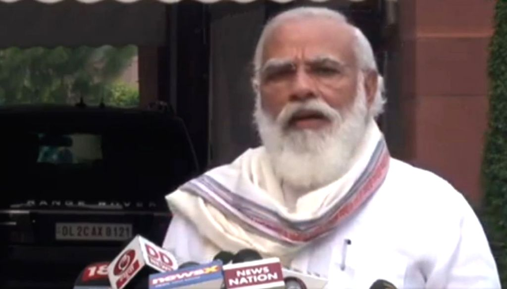 Ahead of the beginning of the Monsoon Session, Prime Minister Narendra Modi talks to the media outside Parliament, in New Delhi on Sep 14, 2020. Modi asserted that major decisions will be ... - Narendra Modi