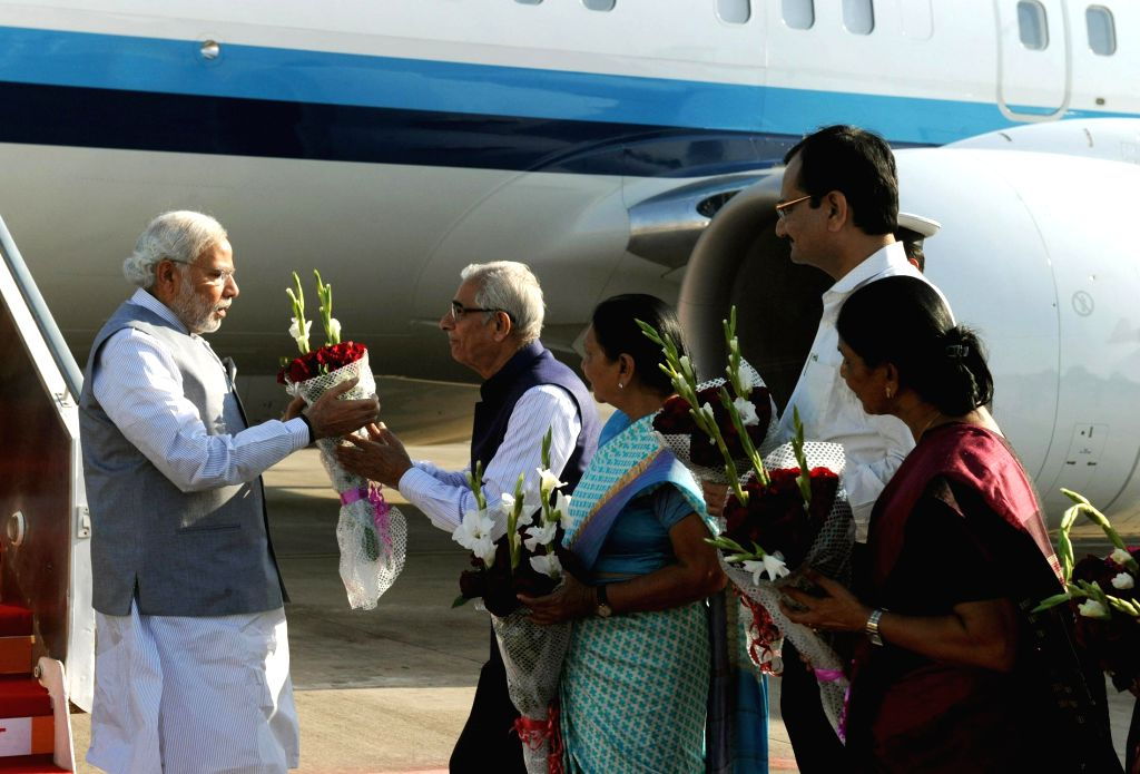 Prime Minister Narendra Modi being received by the Gujarat Governor O.P. Kohli and the Gujarat Chief Minister Anandiben Patel on his arrival, at Ahmadabad airport, in Gujarat on Jan 10, ... - Narendra Modi, P. Kohli and Anandiben Patel