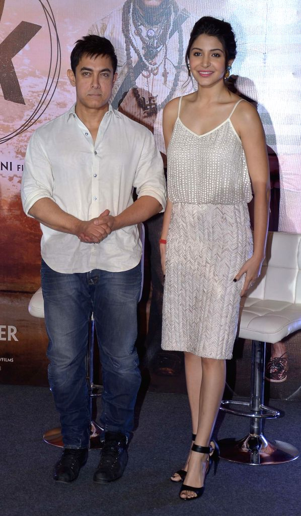 Actors Aamir Khan and Anushka Sharma during the promotions of their upcoming film `PK` in Ahmedabad, on Dec 10, 2014. - Aamir Khan and Anushka Sharma
