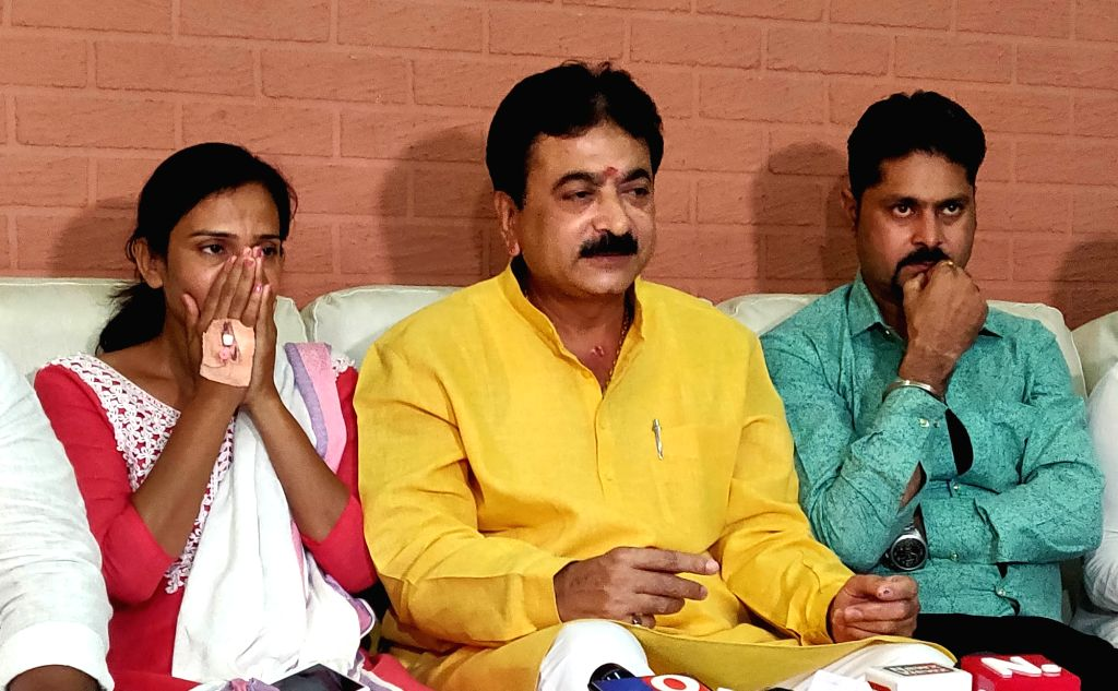 Ahmedabad: Ahmedabad BJP MLA Balram Thawani holds a press conference after he was caught on camera roughing up and kicking a woman on a street following which Gujarat BJP directed him to apologize, in Ahmedabad on  June 3, 2019. Also seen Nitu Tejwan