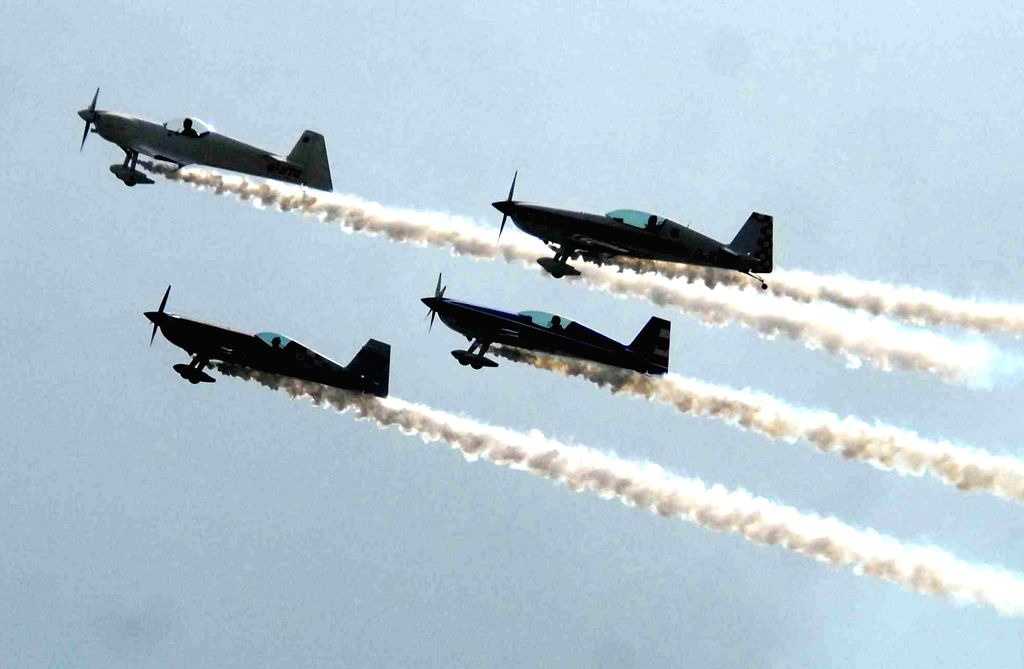 Airplanes present aerobatics during the Aero Conclave and Air Show organised in Ahmedabad, on April 2, 2015.
