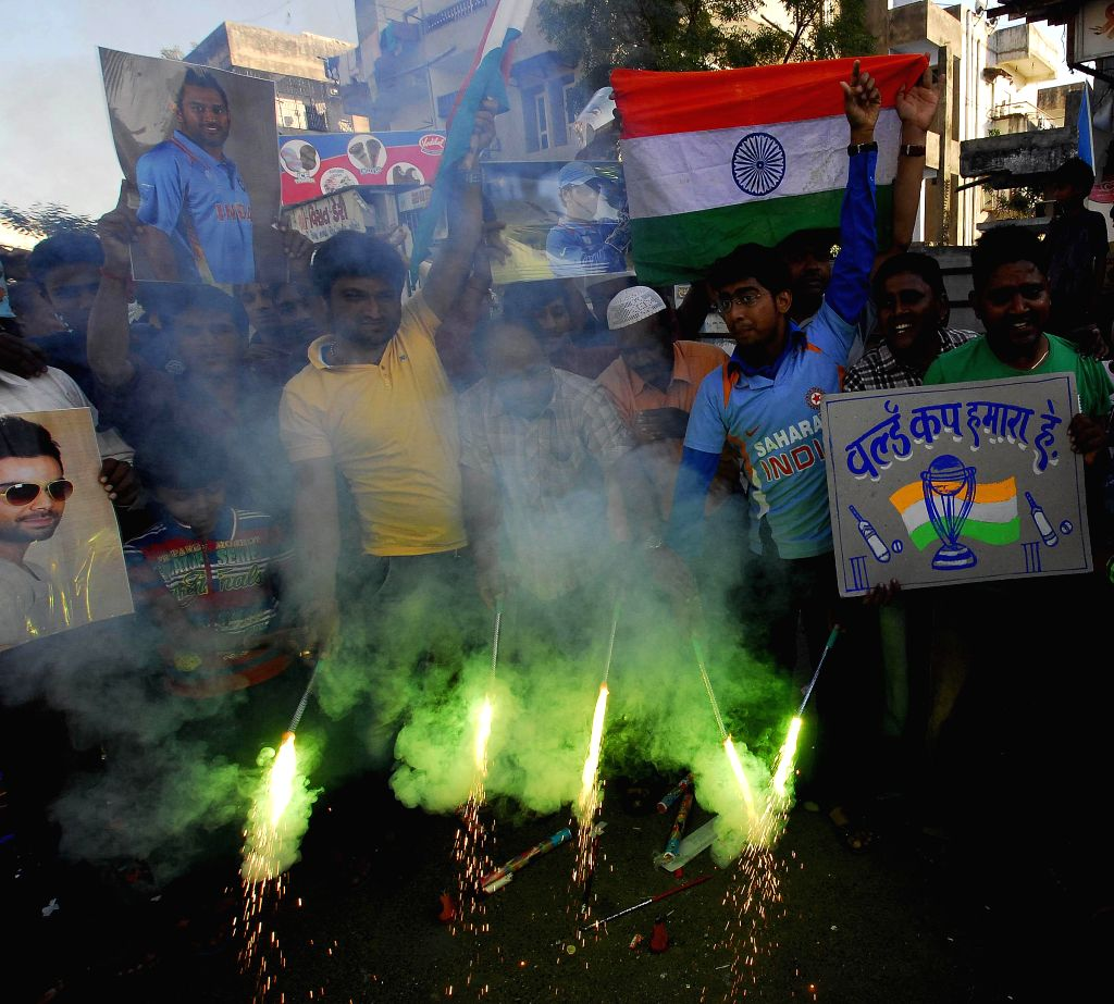 Cricket fans celebrate India's victory over Pakistan in an ICC World Cup 2015 match, in Ahmedabad, on Feb 15, 2015.