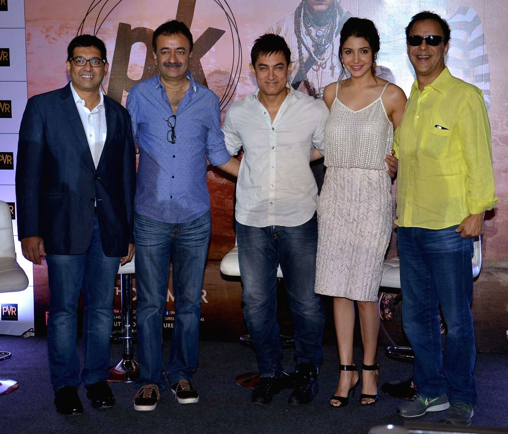 Filmmaker Rajkumar Hirani, with actors Aamir Khan and Anushka Sharma during the promotions of their upcoming film `PK` in Ahmedabad, on Dec 10, 2014. - Rajkumar Hirani, Aamir Khan and Anushka Sharma
